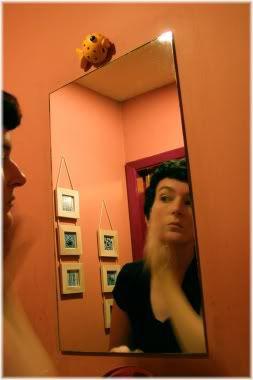 woman applying skin care in mirror