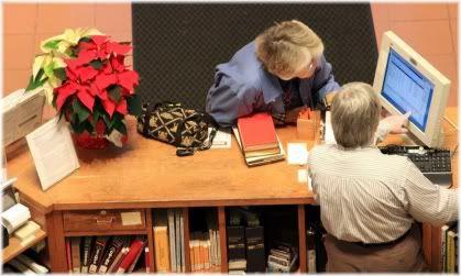 man and woman looking at computer screen