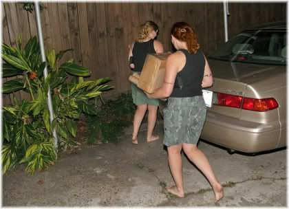 women carrying boxes
