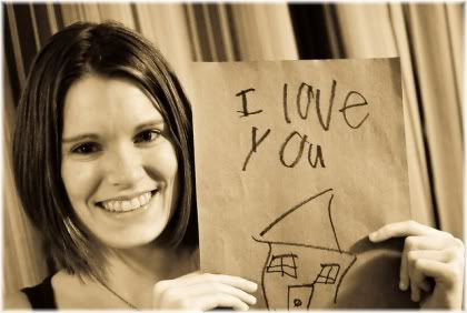 woman holding i love you sign