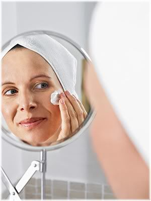 mature woman cleansing face