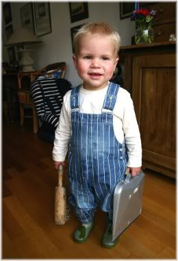 child with dustpan and brush