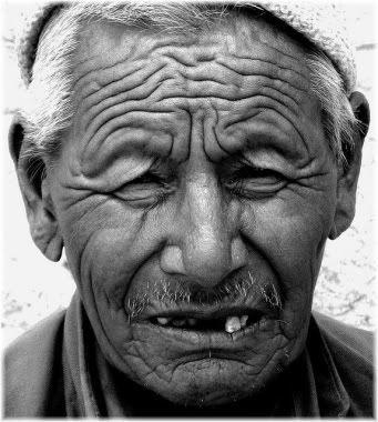wrinkled man's face