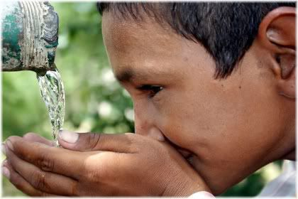 boy drinking water from spring