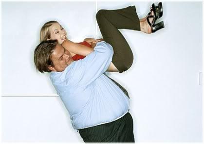 large man holding woman